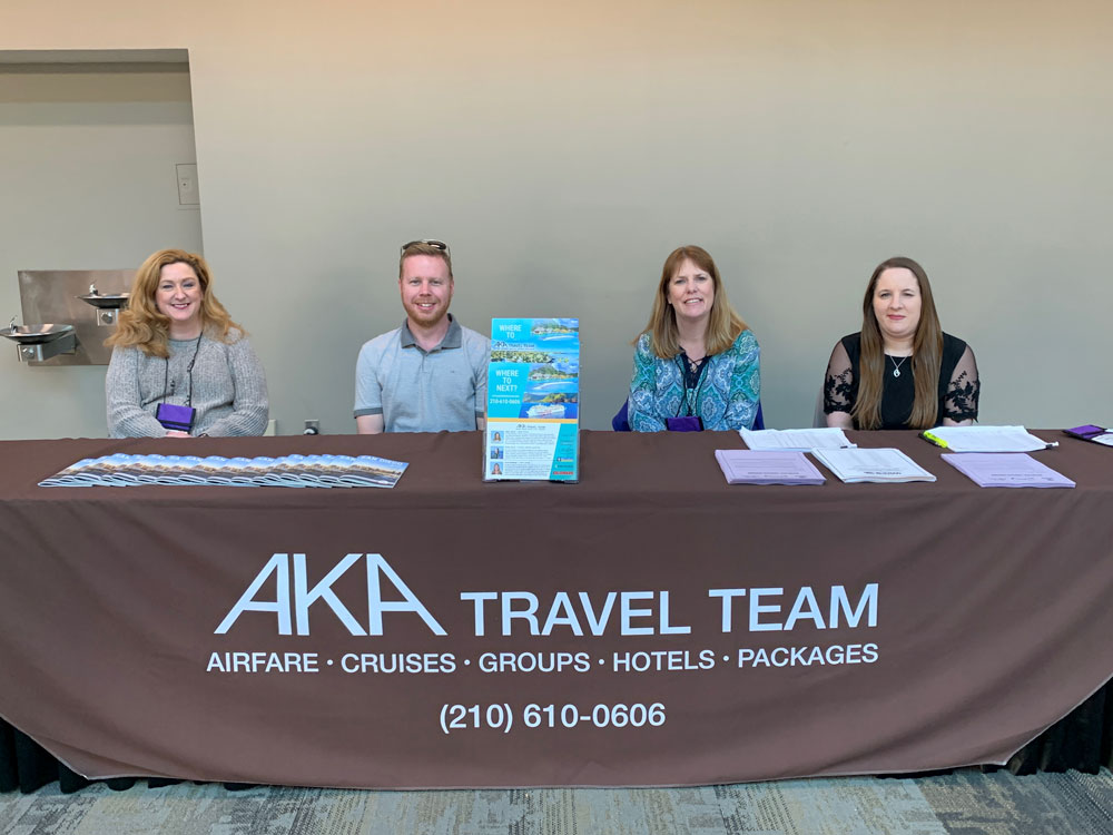 AKA Travel Team at desk